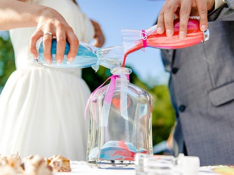 Newlyweds during sand ceremony