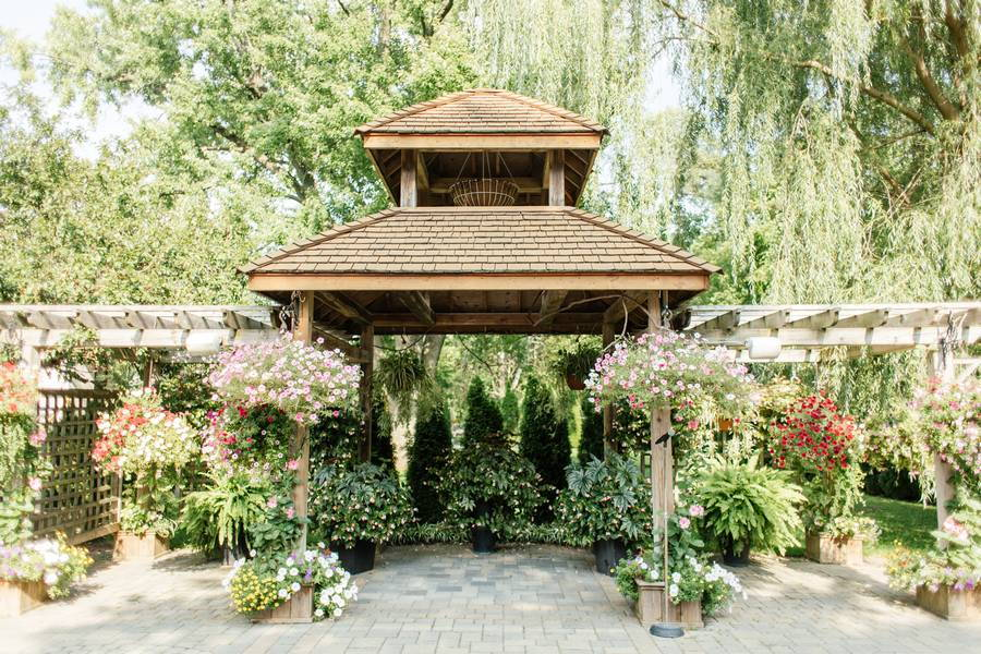 The Madison Greenhouse Event Venue featured in Jodie and Olu's Whimsical Wedding at Madison Greenhouse