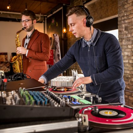 Evolved Entertainment featured in A Trendy Retro-Rustic Wedding Open House at The Jam Factory