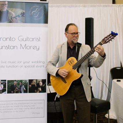 Dunstan Morey Guitarist featured in An Annual Wedding Show at Deer Creek Golf & Banquet Facility