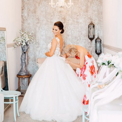 Bridal Hair Collective featured in Veronica and Daniel's Whimsical Vintage Garden Wedding at Bel…