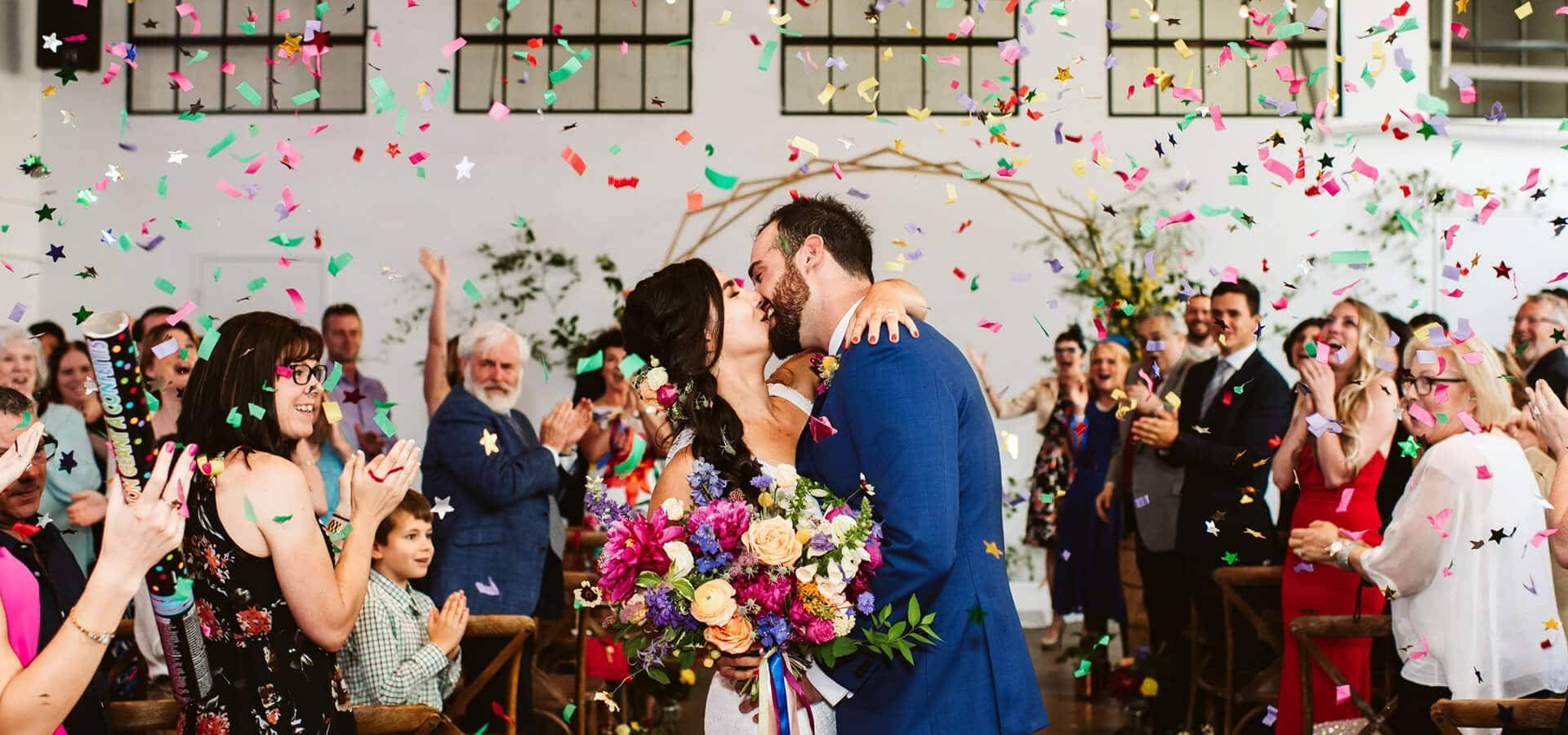 Hero image for Nicole and Luke's Colourful Wedding at the Distillery's Airship 37