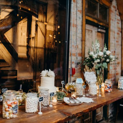 Prairie Girl Bakery featured in Megan and Zak's Romantic Distillery Wedding at Archeo