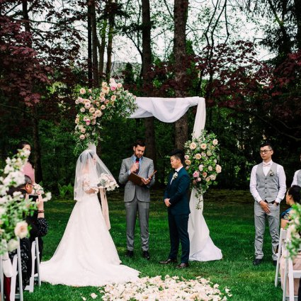 Jonny Belinko Wedding Officiant featured in Emma and Xi's Intimate Affair at a Beautiful Private Residenc…
