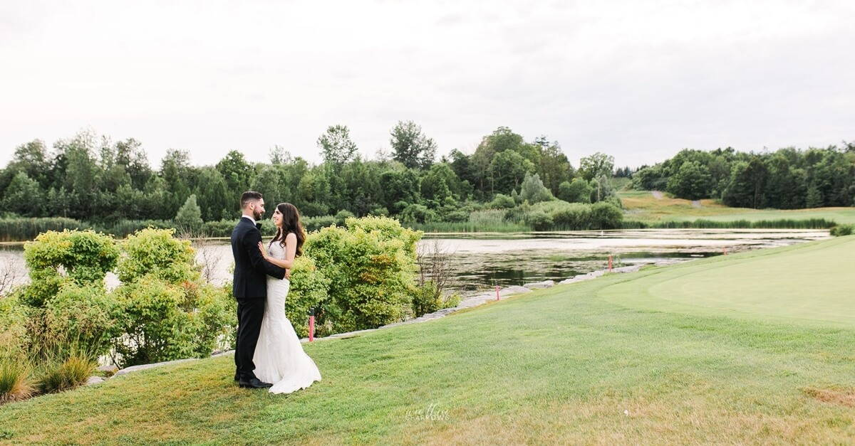 Hero image for Jessica and Christopher's Classic White-and-Green Wedding at Eagles Nest Golf Club