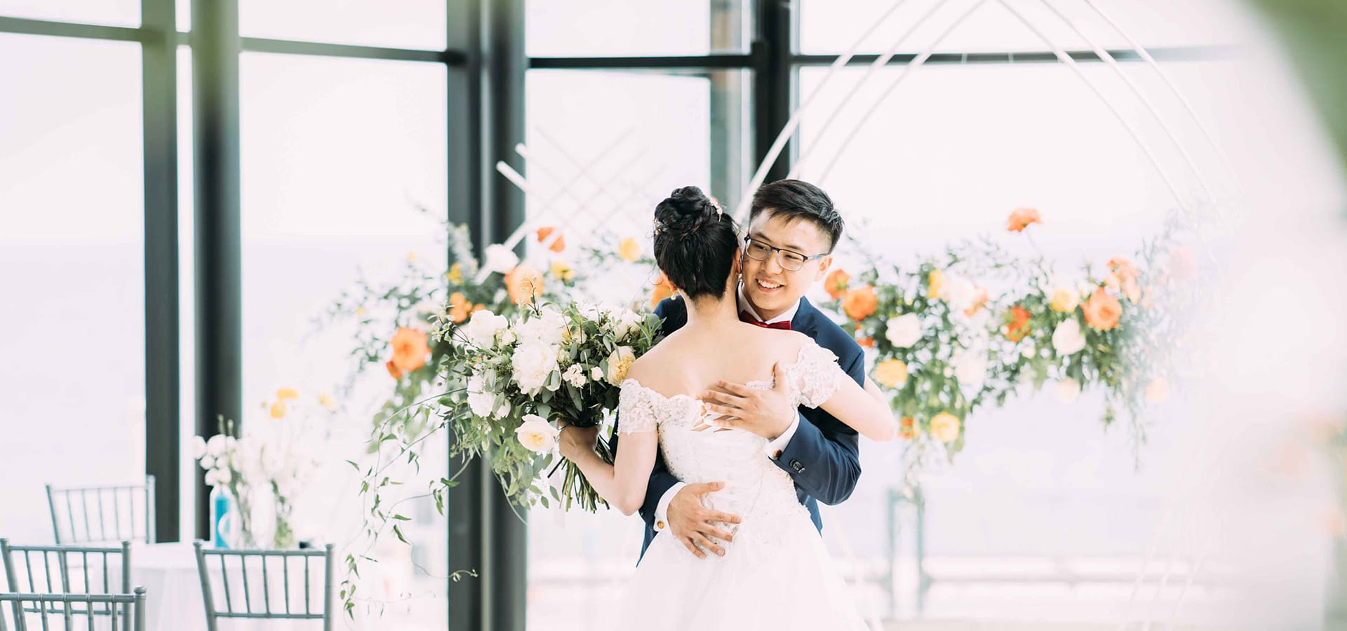 Hero image for Lisa and Jason's Citrus Infused Wedding at Spencer's at the Waterfront