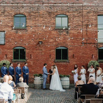 Enduring Promises featured in Cammie and Ryan's Romantic Summer Wedding at Archeo