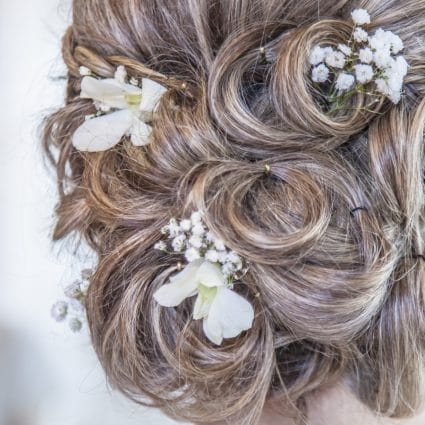 Thumbnail for To Updo or Not to Updo: The Great Wedding Hair Debate
