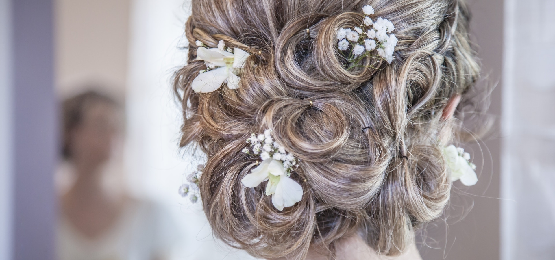 Hero image for To Updo or Not to Updo: The Great Wedding Hair Debate